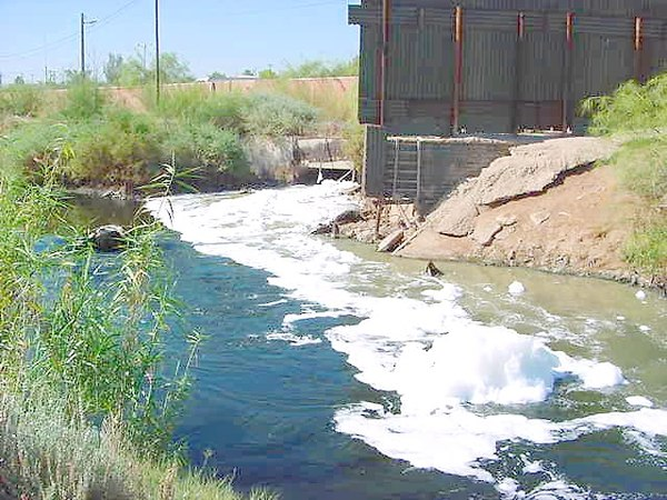 Raw sewage and industrial waste in the New River as it passes from Mexicali (Mexico) to Calexico, California