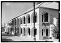 OBLIQUE VIEW OF QUEEN STREET FACADE OF SOBOTKER SECTION - Government House, King Street, Christiansted, St. Croix, VI HABS VI,1-CHRIS,34-21.tif