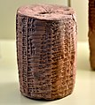 Old Babylonian baked clay cylinder. The Akkadian cuneiform inscription mentions a capacity table. 18th-16th century BCE. From Iraq. Vorderasiatisches Museum, Berlin.jpg