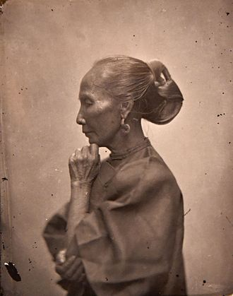 Hairstyle - Elderly Chinese woman with elaborate hair style. John Thomson. China, 1869. The Wellcome Collection, London.