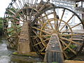 Old Town of Lijiang water wheels front 2.JPG