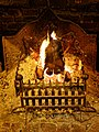Open fire in hearth grate at The Black Horse Inn, Nuthurst, West Sussex.jpg
