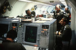 Operations take place inside an E-3A Sentry Airborne Warning and Control System (AWACS) aircraft en route to the tactical large force employment exercise area DF-ST-84-09463.jpg