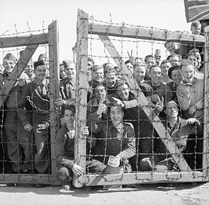 Stalag XI-B - POWs at Stalag XI-B welcome their liberators, 16 April 1945