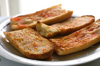 <i>Pa amb tomàquet</i> Traditional food of Catalan, Valencian, Aragonese, Balearic and Murcian cuisines made of bread, tomato, olive oil, salt, and garlic