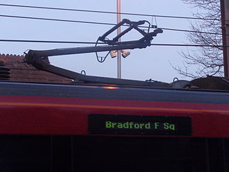 Pantograph (transport) - Close up of a single arm pantograph on a British Rail Class 333.