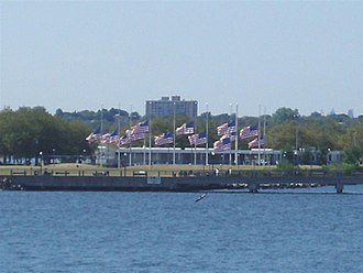 Hudson River Waterfront Walkway - Flags at half-staff in Liberty State Park