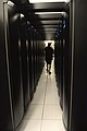 Person walking between Hopper Cray XE6 racks.jpg