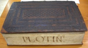 Allegorical interpretations of Plato - Oxford University's 1492 edition of Plotinus' Enneads, translated into Latin by Ficino, with its original stamped, checkerboard binding in calf over wooden boards. Holes for chain staples and the manuscript title on the text block show chained volumes were shelved with spines to the rear. This copy is thought to have belonged to the royal library of King Philip II of Spain.