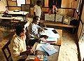 Polling officials reached with the Electronic Voting Machine (EVM), at a polling booth for the 2nd phase of General Assembly Election, at Hajo Constituency, Kamroop District, in Assam on April 10, 2016.jpg