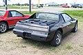 Pontiac Fieros 84 2M4 & 86 GT (9139878306).jpg