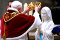 Pope Benedict XVI placing a novelty crown on Our Lady of Lourdes on occasion for the sick pilgrims, 11 February 2007.jpg