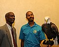 Posing for picture with Bald Eagle. (10595028974).jpg