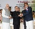 Pranab Mukherjee presenting the National Award for Teacher-2011 to Shri Nek Ram, Himachal Pradesh, on the occasion of the 'Teachers Day'.jpg