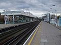 Putney Bridge stn through eastbound platform look westbound.JPG