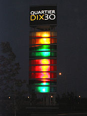Quartier DIX30 tower night.jpg