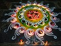 Rangoli with small lamps in a puja at a temple 1.jpg