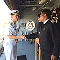 Rear Adm. Tom Reck, left, is greeted by Capt. Jabu Mbotho.jpg