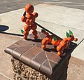Redlands' orange person walking orange dog sculpture.jpg
