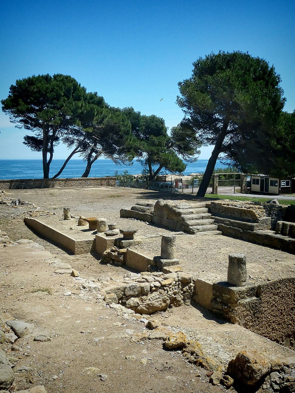 Remains of Greek temple in the ancient Greek city of Neapolis at the archaeological site of Empúries