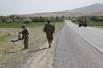 Saydabad District - American soldiers checking for militant-planted IEDs by a road in Sayedabad district of Wardak Province, Afghanistan.