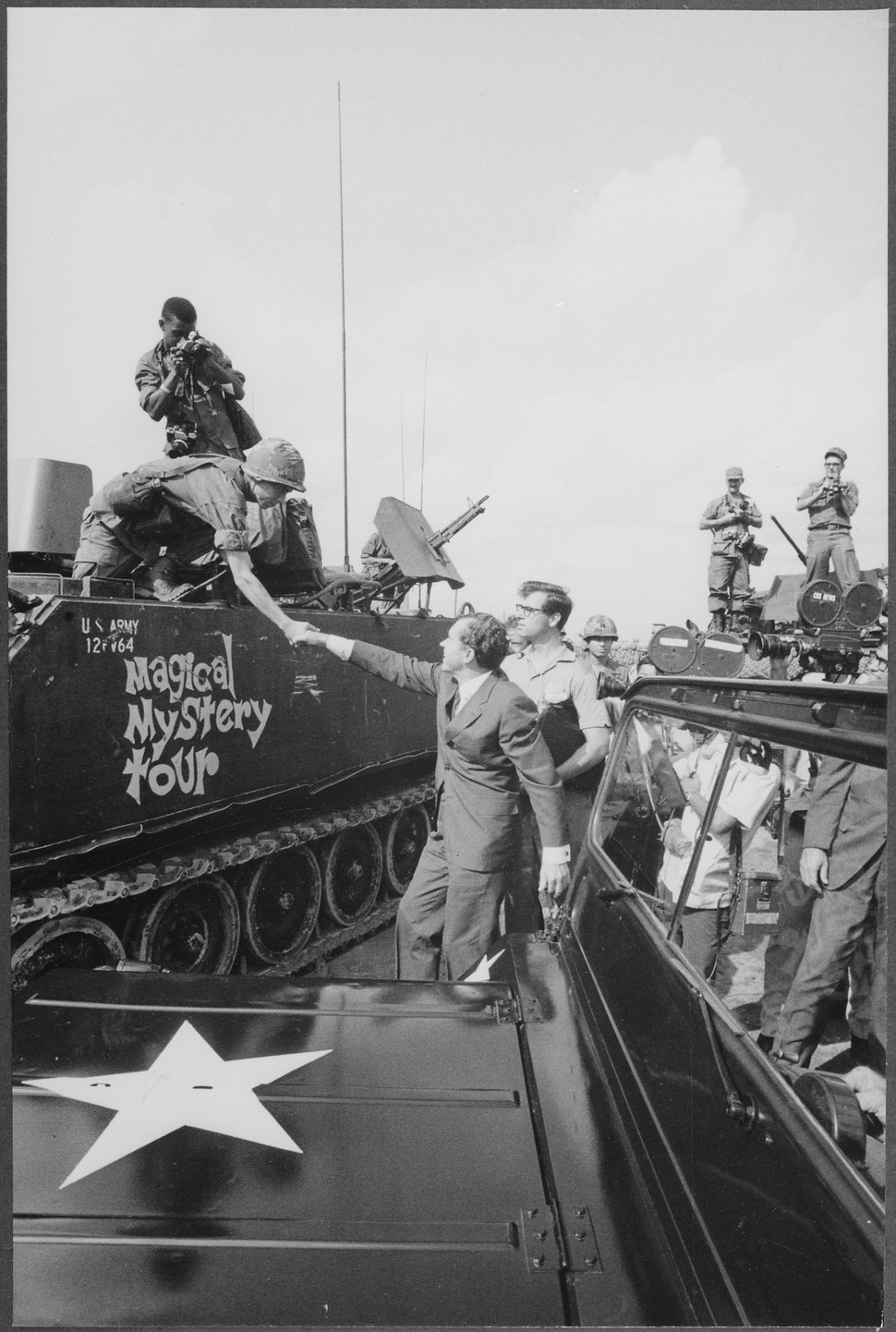 Richard M. Nixon shaking hands with armed forces in Vietnam - NARA - 194650