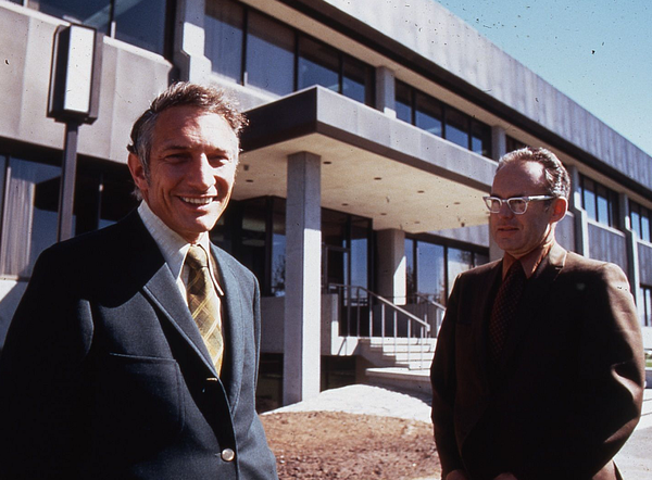 Noyce and Gordon Moore in front of the Intel SC1 building in Santa Clara in 1970. Robert Noyce and Gordon Moore at SC1 1970.png