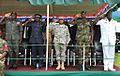 Robert S. Ferrell and Gambian officers saluting.jpg