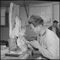 Rohwer Relocation Center, McGehee, Arkansas. In a wood carving class, this center resident, a form . . . - NARA - 539386.tif