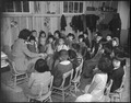 Rohwer Relocation Center, McGehee, Arkansas. Miss Margaret Morrisy. Story hour in the first grade. - NARA - 538955.tif