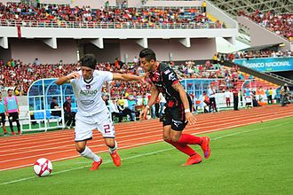 Liga FPD - Saprissa's Christian Bolaños disputes the ball against Alajuelense's Rónald Matarrita. Alajuelense and Saprissa have the biggest rivalry in the league, known as El Clásico