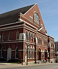 Photograph of the brick façade of Ryman Auditorium on a sunny day.
