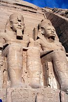 Four colossal statues of Ramesses II flank the entrance of his temple Abu Simbel.