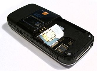 SIM card - A mini-SIM card next to its electrical contacts in a Nokia 6233