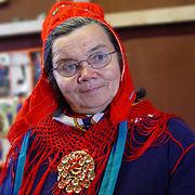 Sámi wearing her traditional garb.