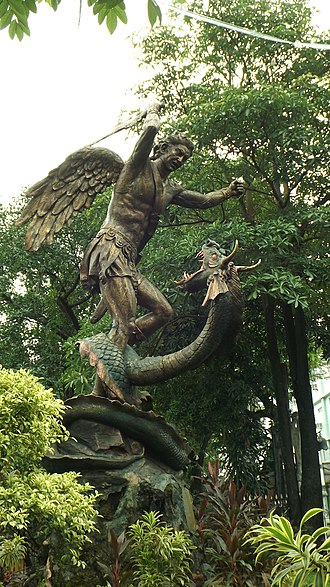 San Miguel Church (Manila) - Statue of Saint Michael fighting the Devil, depicted as a dragon, in the parvise of the church.