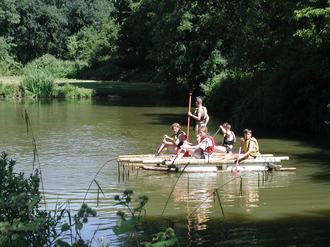 Scouts (The Scout Association) - A Scout Patrol paddling the raft which they had built at Tolmers Scout Camp in Hertfordshire, 2007.