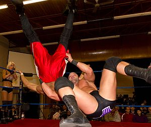 Tye Dillinger - Spears performing a belly to back suplex in December 2011