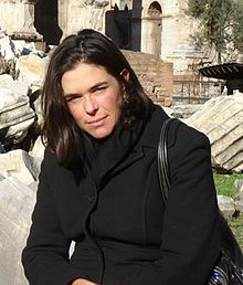Sian Beilock sitting in front of ruins in Rome, Italy in December 2007