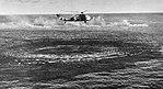 Sikorsky HSS-1 of HS-2 in flight and lowering sonar, in 1960.jpg