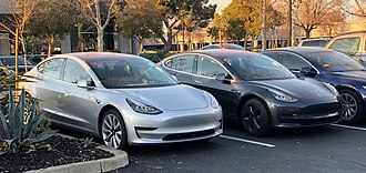 Tesla Model 3 - Tesla Model 3s in colors Silver Metallic (left) and Midnight Silver (right)