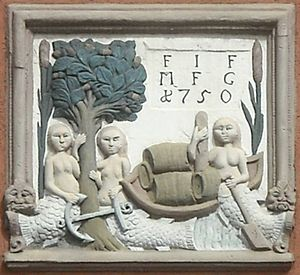 Sélestat - An 18th-century relief on a house in the old town. It recalls the origins of Sélestat: the three mermaids symbolise the Ill river and its tributaries Lièpvrette and Giessen, the tree and reed stand for the Illwald forest and marshes, and the boat evokes the wine trade.