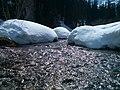 Snowy banks along creek at Lake Louise in Banff.jpg