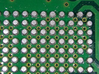 Ball grid array - A grid array of solder balls under an integrated circuit chip, with the chip removed; the balls were left attached to the printed circuit board.