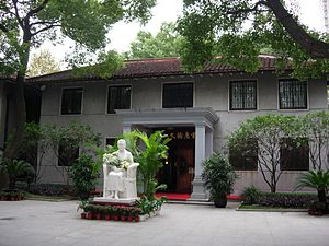 Soong Ching-ling Memorial Residence (Shanghai) - Exhibition hall building at Song Ching Ling's former residence in Shanghai, with a sculpture of Song Ching Ling in front.