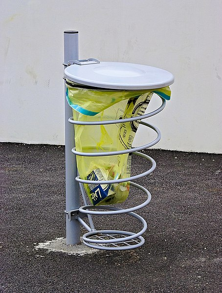 A public waste bag with spiral holder. Soyaux, Charente, France.
