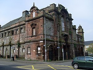 Springburn - The derelict B-listed former Springburn Public Halls, April 2009. The building, a gift to the community from the Reid family of Neilson, Reid and Company, was opened in 1902 and later used as Springburn Sports Centre from 1960, until it was closed by Glasgow District Council due to dry rot problems in May 1985. A proposal by Spectrum Properties in 2009 to convert the building into an office complex and childcare centre was awarded planning permission, but never went ahead. The building was demolished by Glasgow City Council on 27 December 2012.