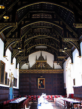 Linenfold - The lower parts of the walls of the 16th century dining hall of St John's College, Cambridge are covered with wood panelling in a linenfold design.