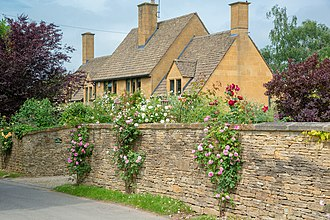 Cotswolds - Typical stone cottage and wall in Stanton