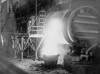 Mount Isa Mines - Pouring from a Peirce-Smith copper converter, Mount Isa, 1954.